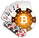 The bitcoin symbol with cards and chips.